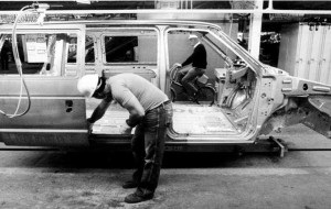 File photo of an autoworker installing a sliding door on a new Chrysler minivan in 1983 (Windsor Star)